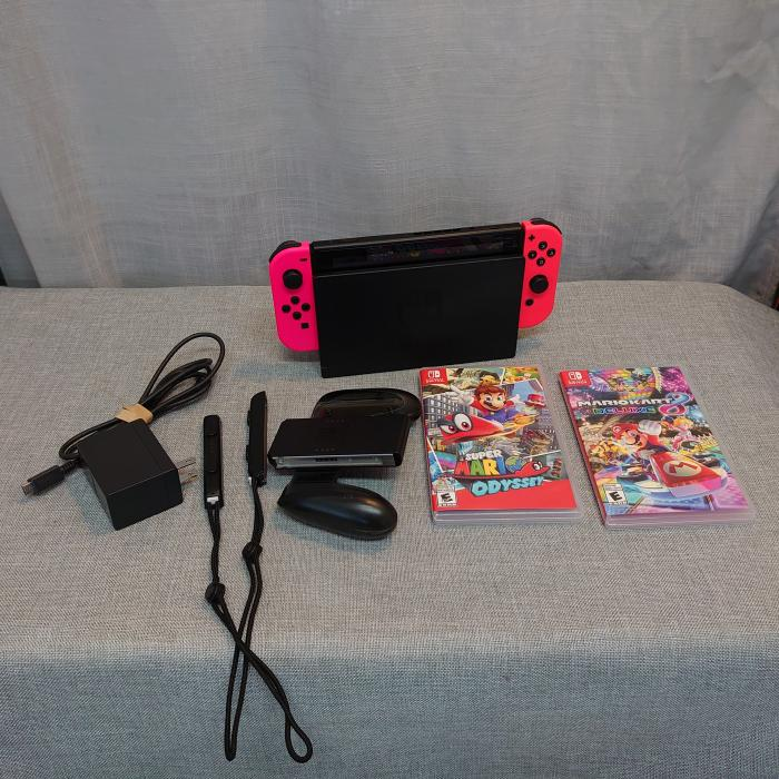 Nintendo Switch like new + 2 Mario Games